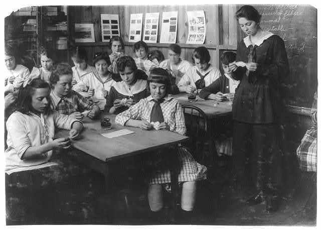Continuation School group at Ipswich Mills, South Boston, studying textiles.  Location: Boston, Massachusetts / Lewis W. Hine.