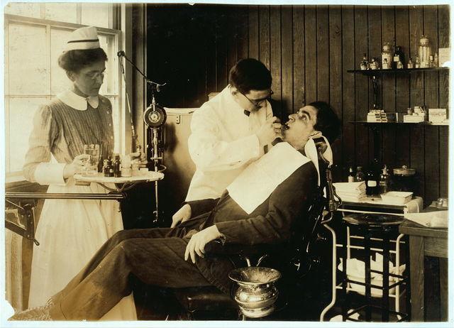 [Dental work in Hospital. Hood Rubber Co., Cambridge.]  Location: [Cambridge, Massachusetts] / [Lewis W. Hine]