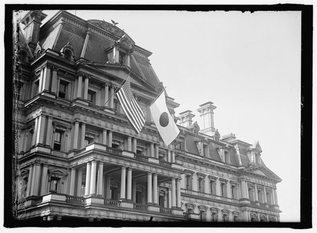 FLAGS. JAPANESE AND UNITED STATES FLAGS ON STATE, WAR, AND NAVY BUILDING; JAPANESE MISSION