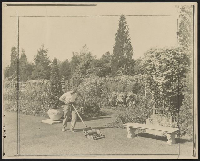 [Gardener pushing lawn mower, posed to illustrate Rudyard Kipling's poem The Glory of the Garden]