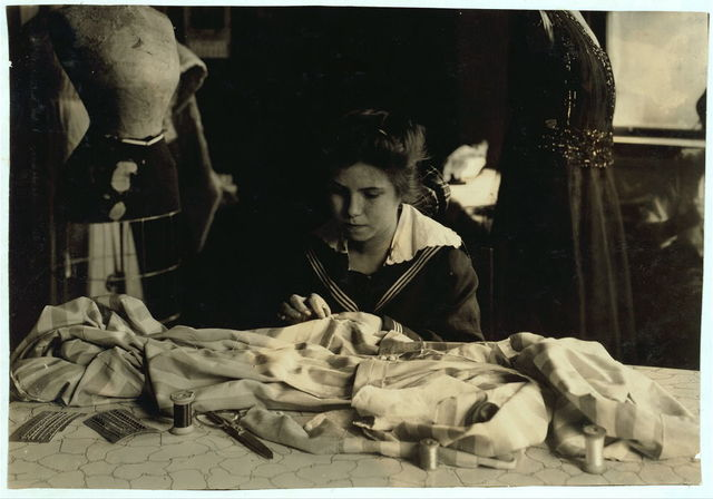 """Helen Anderson, 16 years old. Works for Madame Robinson """"Gowns,"""" Copley Square, Pierce Building.  Location: Boston, Massachusetts / Lewis W. Hine."""