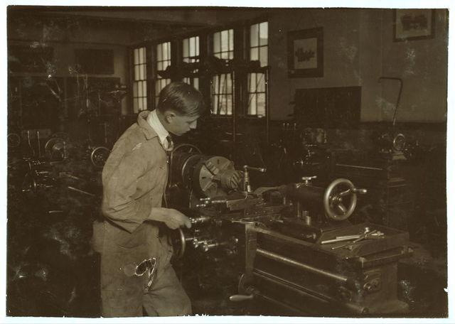 High School boy at work in machine shop. Oklahoma City High School.  Location: Oklahoma City, Oklahoma / Lewis W. Hine.