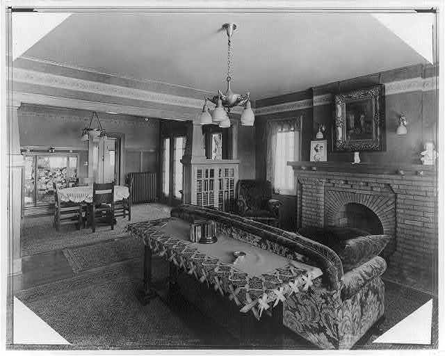 [Interior of home showing living room and dining room]
