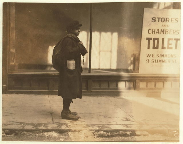 Joseph Amico, photographed at 11 a.m. on Washington Street. Delivering shoes for National Shoe Repair Co., 21 School Street. Said 14 years old. Beginning at $5 a week.  Location: Boston, Massachusetts / Lewis W. Hine.
