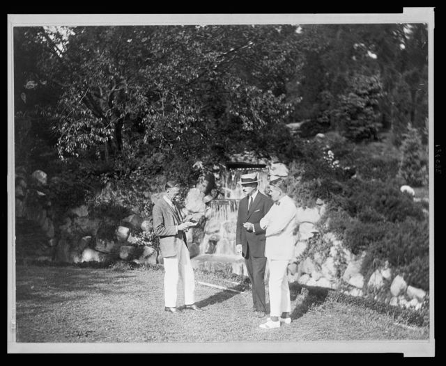 [Joseph Lindon Smith, Albert Herter, and Evan Evans standing by the waterfall at the Rosemary Open-Air Theatre, Huntington, Long Island, site of the National Red Cross Pageant, Oct. 5, 1917]