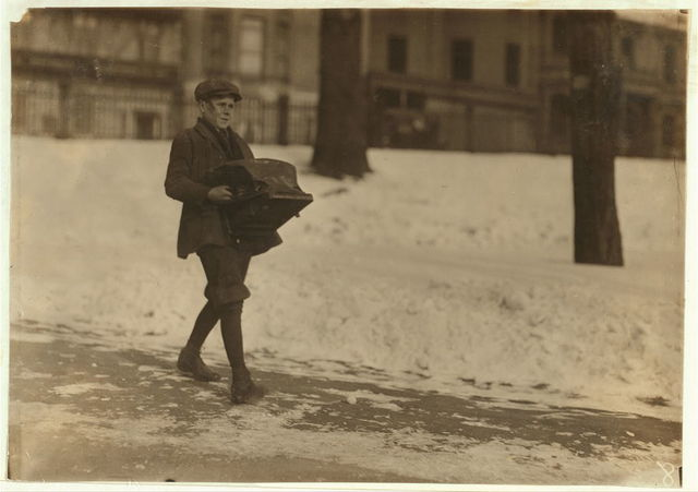 Louis A. Caulfield, 37 Belfort Street, Dorchester. Delivering a heavy type-writer about half a mile. Works for Model Typewriter Inspection Co. Says he is sixteen years old and gets $6 a week. Taken on Boston Common.  Location: Boston, Massachusetts / Lewis W. Hine.