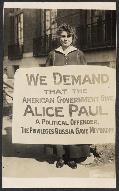 """[Lucy Branham protests the political imprisonment of Alice Paul with """"Russia"""" banner.]"""