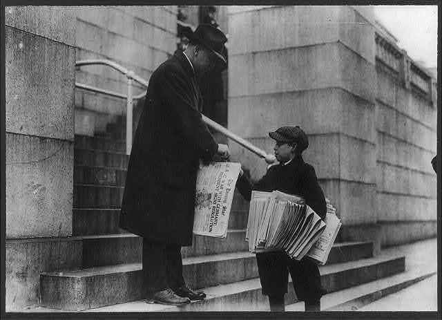 """[Man buying The Evening Star from newsboy, Washington, D.C. - headline reads """"U.S. at War with Germany""""]"""