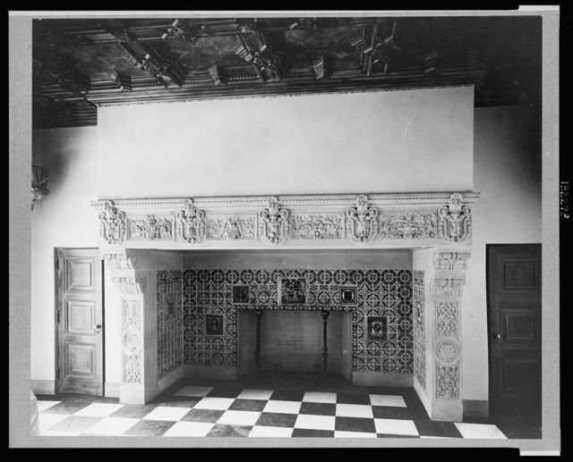 Pasadena, California, Mrs. Herbert Coppell home (interior) - enormous and elaborately decorated fireplace / photo by Frances Benjamin Johnston.
