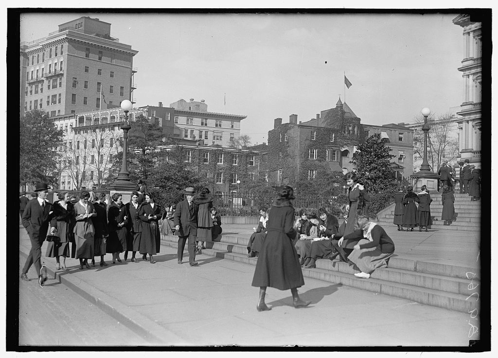[Pedestrians on steps of southwest corner of the State, War, & Navy Building, with the 500 block of 17th Street, N.W., behind, Washington, D.C.]