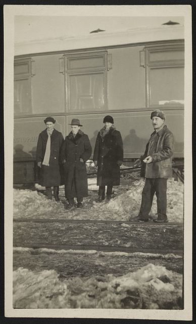 [Pringle and his traveling companions, Peden, Dewart, and Bergen, the translator, in front of train at Vereshchagino]