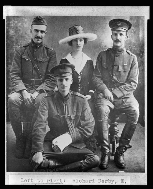 [Richard Derby, Archie Roosevelt in front, Eleanor and Kermit Roosevelt, full-length portrait, sitting, facing front, the men in military uniform]