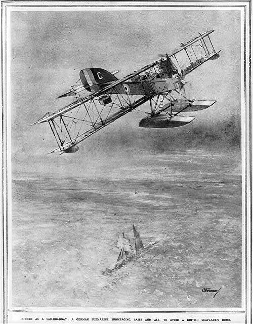 Rigged as a sailing-boat: a German submarine submerging, sails and all, to avoid a British seaplane's bomb