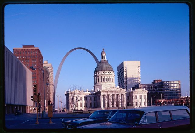 Saint Louis Gateway Arch (originally Jefferson National Expansion Memorial), Saint Louis, Missouri, 1947-65; dedicated, 1968. View with courthouse