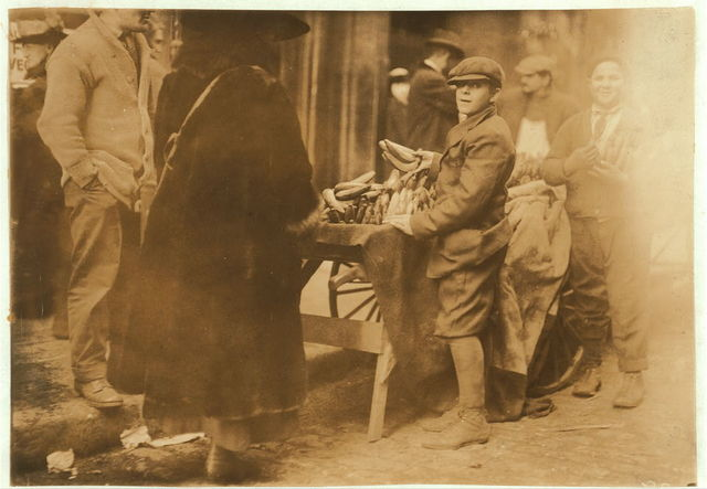 Selling bananas at market.  Location: Boston, Massachusetts / Lewis W. Hine.