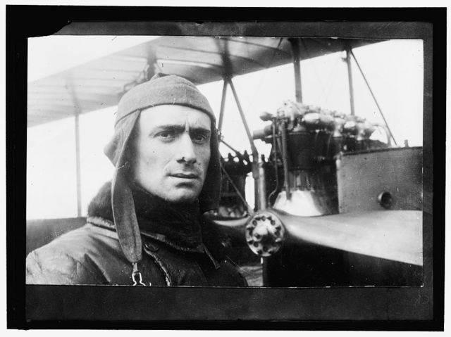 SEMPRINI, ITALIAN AVIATOR, WITH PLANE