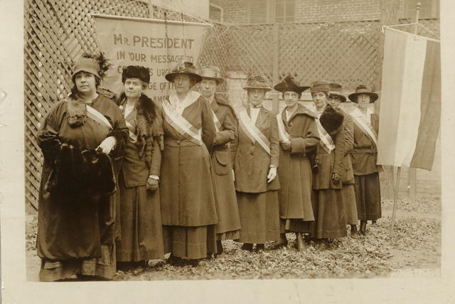 Some of the picket line of Nov. 10, 1917. Left to right: Mrs. Catherine Martinette, Eagle Grove, Iowa. Mrs. William Kent, Kentfield, California. Miss Mary Bartlett Dixon, Easton, Md. Mrs. C.T. Robertson, Salt Lake City, Utah. Miss Cora Week, New York City. Miss Amy Ju[e]ngling, Buffalo, N.Y. Miss Hattie Kruger, Buffalo, N.Y. Miss Belle Sheinberg, N.Y.C. Miss Julia Emory, Baltimore, Md.