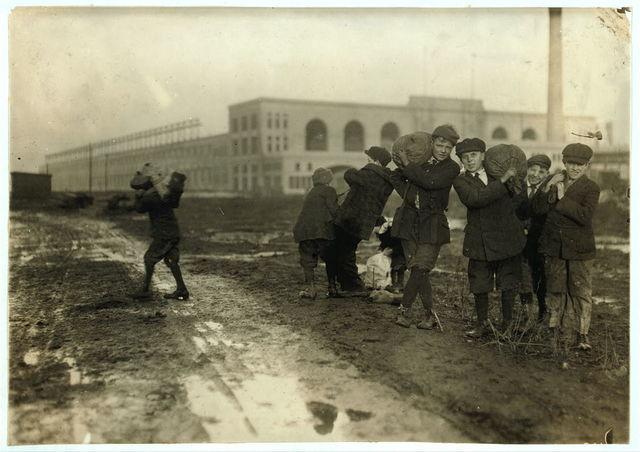 [Stealing coal from railroad coal-yard.]  Location: [Boston, Massachusetts] / Lewis W. Hine.