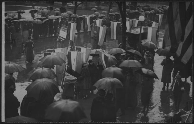 [Suffragists picketing with banners in the rain during the Grand Picket] Mar. 4, 1917.