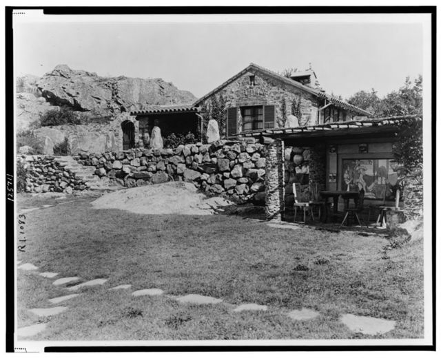 """[""""Surprise Valley Farm,"""" Arthur Curtiss James property, Beacon Hill Road, Newport, Rhode Island. Terrace and superintendent's house with view of stone hillside in distance]"""