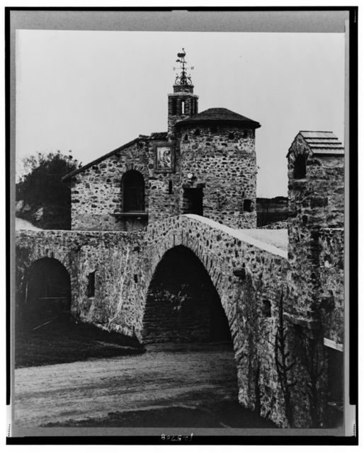 """[""""Surprise Valley Farm,"""" Arthur Curtiss James property, Beacon Hill Road, Newport, Rhode Island. Archway with turret and weathervane in background]"""