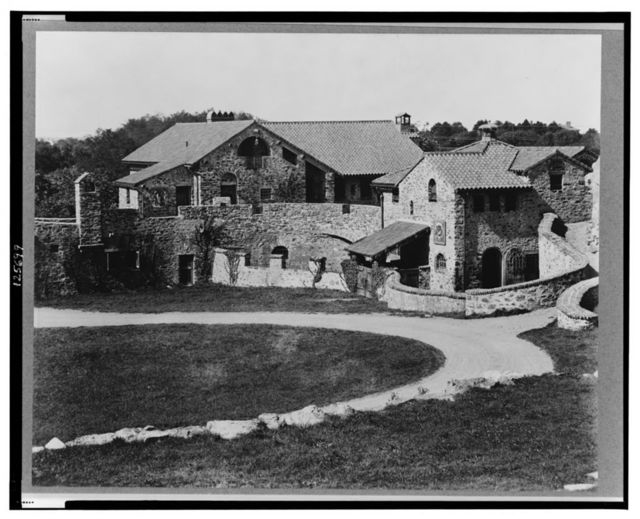 """[""""Surprise Valley Farm,"""" Arthur Curtiss James property, Beacon Hill Road, Newport, Rhode Island. Courtyard and stone buildings]"""