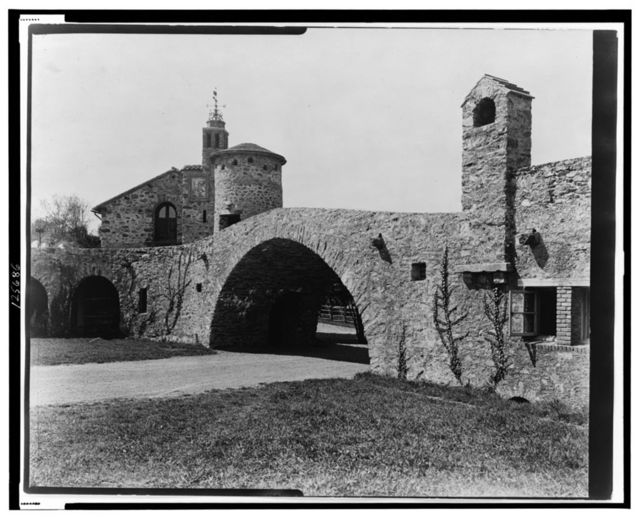 """[""""Surprise Valley Farm,"""" Arthur Curtiss James property, Beacon Hill Road, Newport, Rhode Island. Archway with stone buildings]"""