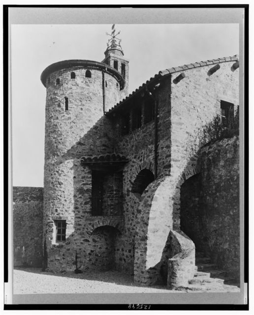 """[""""Surprise Valley Farm,"""" Arthur Curtiss James property, Beacon Hill Road, Newport, Rhode Island. Detail of masonry with turret in background]"""