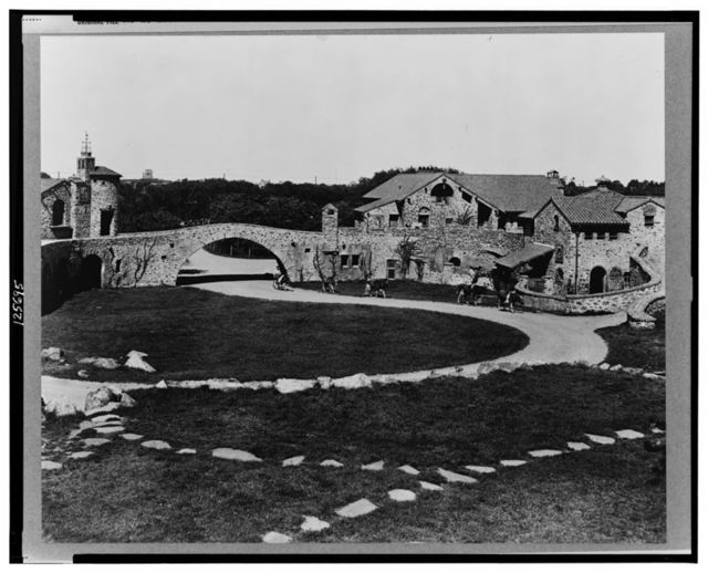 """[""""Surprise Valley Farm,"""" Arthur Curtiss James property, Beacon Hill Road, Newport, Rhode Island. Courtyard with cattle being driven along pathway]"""
