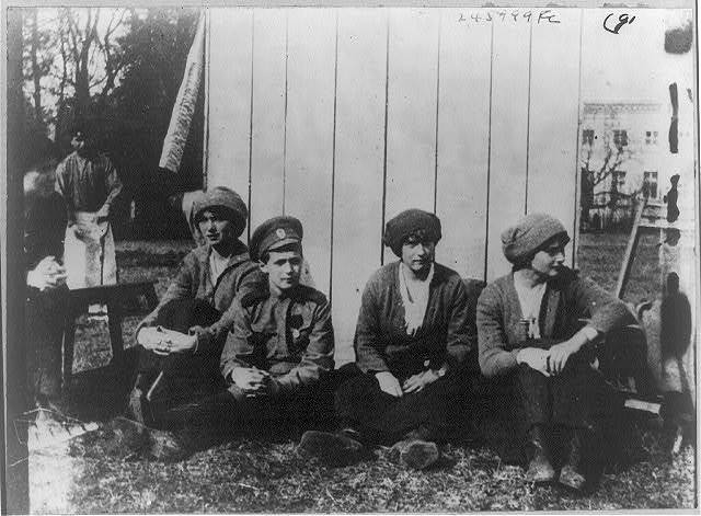 The Russian royal children resting after working in the garden at Tsarskoe Selo. Left to right: Olga Nicolaevna, Alexis Nicolaevitch, Anastasie and Tatiana Nicolaevna