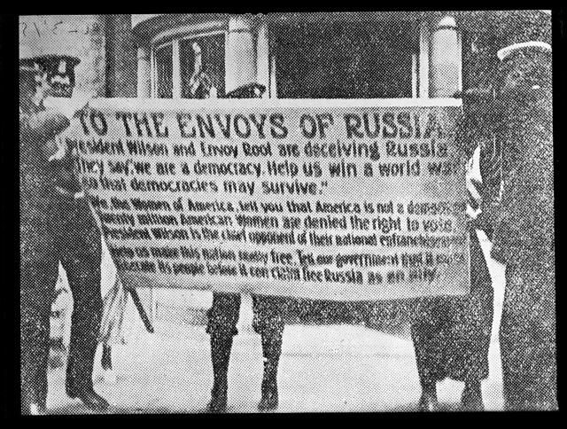 To the Envoys of Russia. President Wilson and Envoy Root are deceiving Russia. They say we are a democracy. Help us win a world war so that democracies may survive. We, the Women of America tell you that America is not a democracy [...]