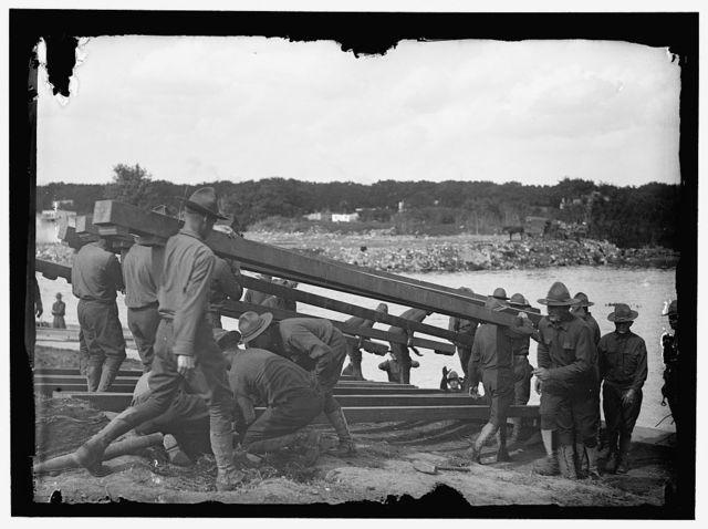 [US Army Engineering unit building a pontoon bridge at Washington Barracks, Washington, D.C.]