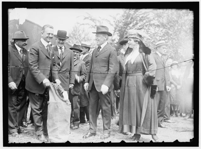 AIR MAIL. INAUGURATION OF SERVICE, POLO FIELD. START OF 1ST CONTINUOUSLY SCHEDULED SERVICE. CURTISS JN-46-H PLANE. PRESIDENT AND MRS. WILSON