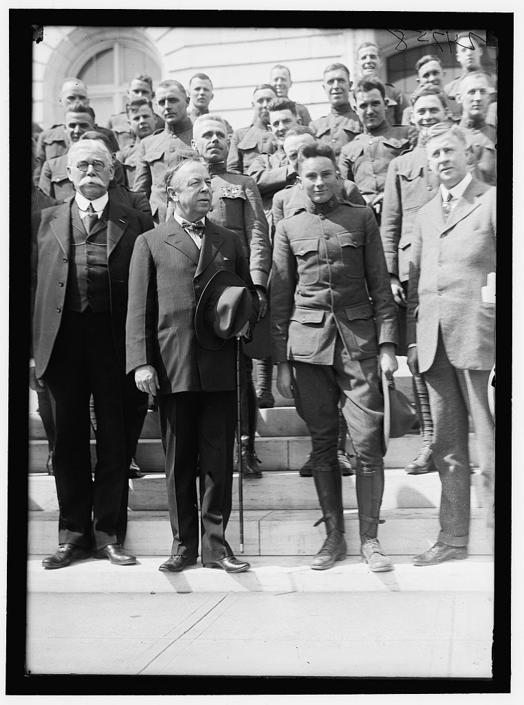 ARMY, U.S. GROUP OF SOLDIERS ON STEPS OF SENATE OFFICE BUILDING WITH SENATORS McNARY, WARREN, CHAMBERLAIN, ?, AND MckELLAR. A SOLDIER IN FRONT OF SENATORS