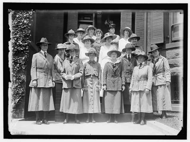 GIRL SCOUTS. NATIONAL AND LOCAL OFFICERS, LEFT, MRS. JAMES STORROW OF BOSTON; 2ND FROM LEFT FRONT, MRS. JULIETTE LOW, FOUNDER; 4TH FROM LEFT FRONT, VERA LAWRENCE, DIST. COMMANDR.; ABOVE LAST, AT RIGHT, MRS. FR[...]