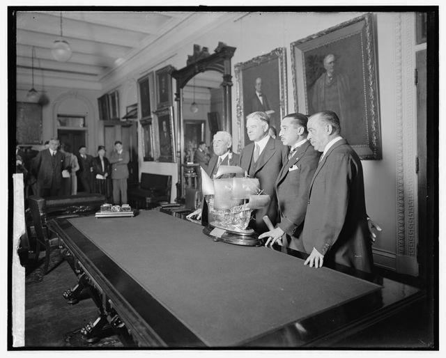 Hoover receiving trophy of King of Spain