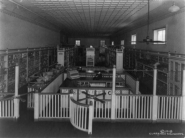 [Interior of a Piggly Wiggly self-service grocery store in or near Memphis, Tenn., with two turnstiles in foreground]