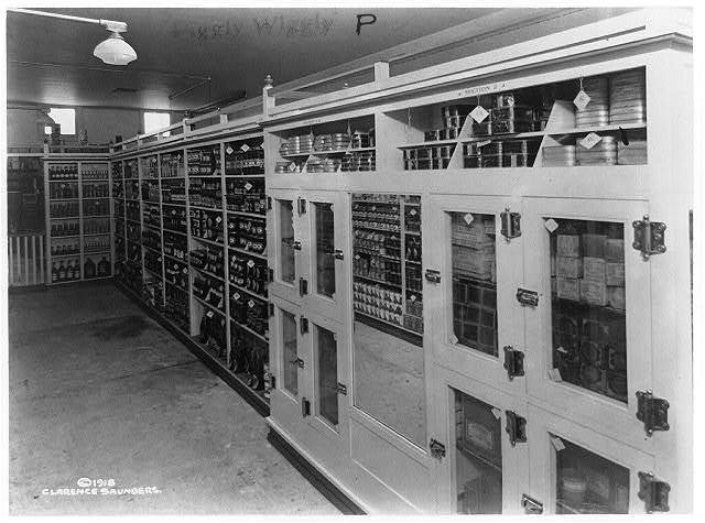 [Interior view of a Piggly Wiggly self-service grocery store showing merchandise on shelves]
