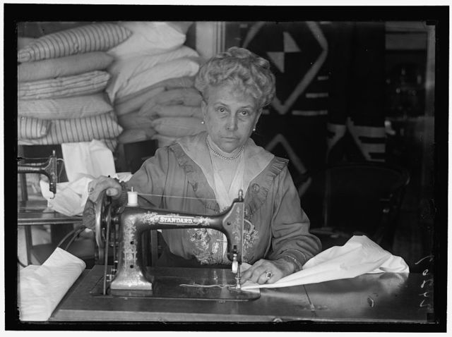 LEGION OF LOYAL WOMEN. MRS. MARY LOGAN TUCKER, SEWING ON BEDDING FOR HOSPITALS