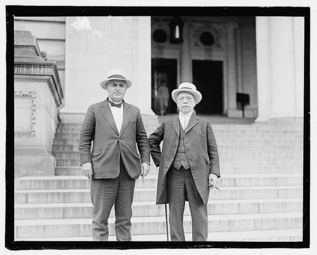 [Samuel Gompers and Frank Walker.] One figure holding cane at side