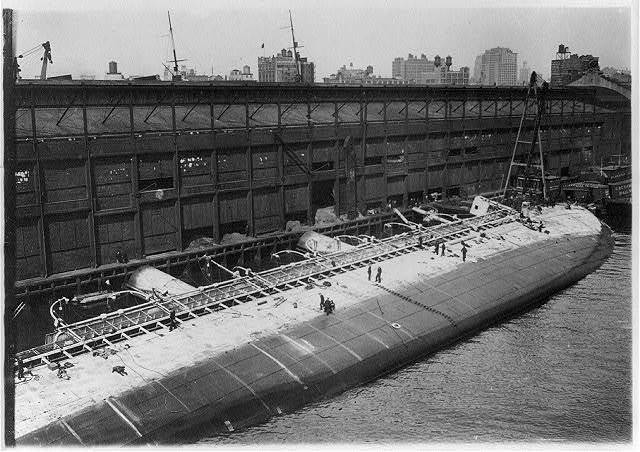 [S.S. ST. PAUL as she lay on the bottom of the North River, New York City. Hull of raised ocean liner lying on its sie a pier]