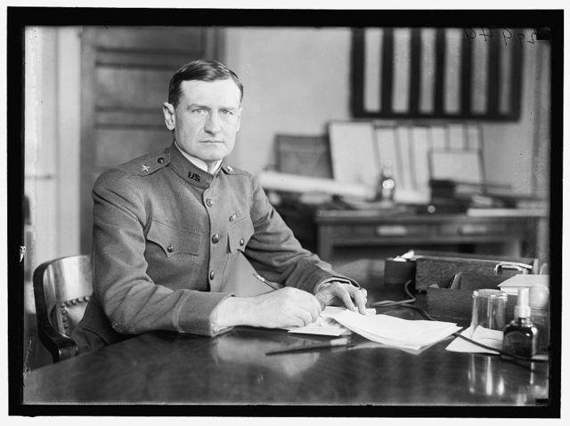 WOOD, ROBERT E. BRIG. GENERAL, U.S.A., ACTING Q.M. GENERAL. AT DESK IN MUNITIONS BUILDING