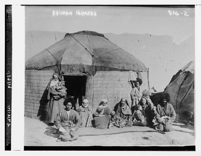 Afghan nomads, seated outside tent