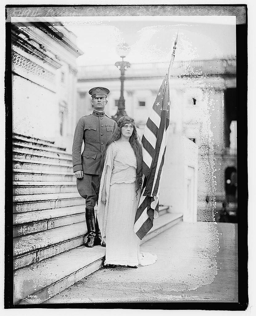 Belgian Pageant: Lt. Col. F.M. Barrows and Maude Howell Smith [as Columbia]