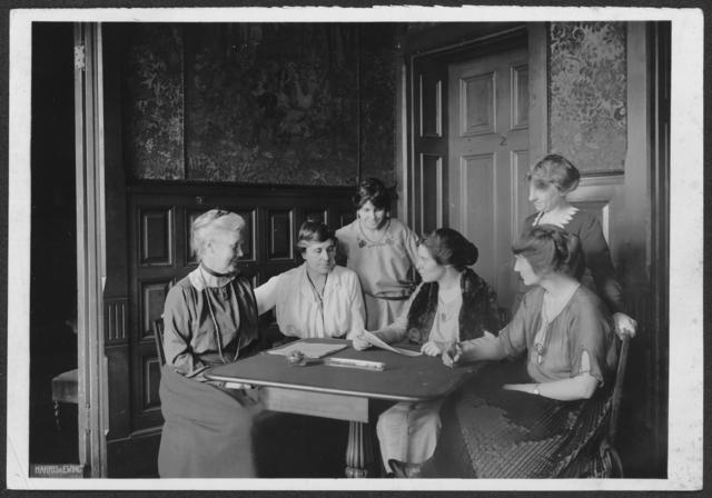 Conferring over ratification [of the 19th Amendment to the U.S. Constitution] at  [National Woman's Party] headquarters, Jackson Pl[ace] [Washington, D.C.].  L-R Mrs. Lawrence Lewis, Mrs. Abby Scott Baker, Anita Pollitzer, Alice Paul, Florence Boeckel, Mabel Vernon (standing, right)