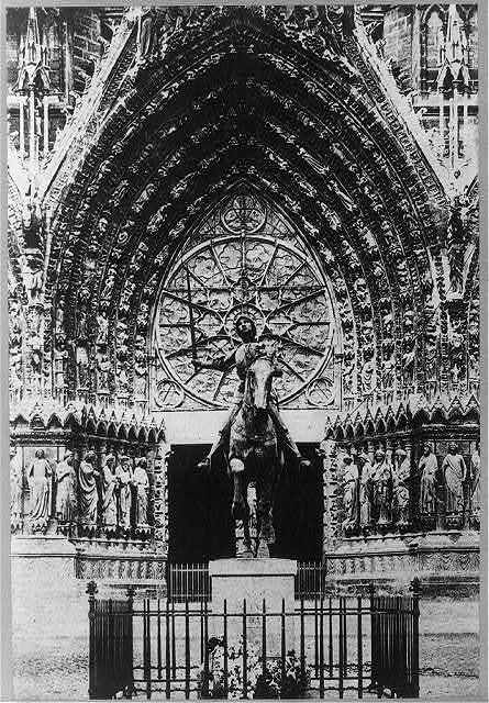 [Entrance to cathedral of Reims, France, and equestrian statue of Joan of Arc]