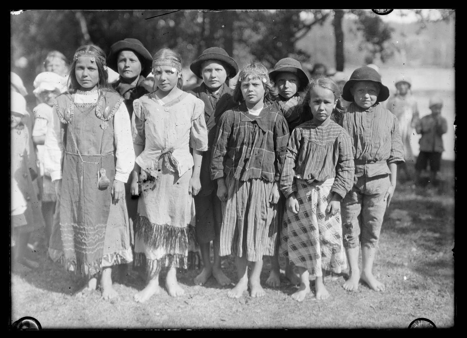 Finland News Service, WAR ORPHANS OF FINLAND, Children of an orphan home at Viborg, Finland who know of American children because of the Junior Red Cross is helping them with food and clothing. They are dressed for one of the Finnish folk dances in honor of a visit of their American benfactors. Finland is making brave efforts to improve the health and environment of its children. Like several other European states that have won their freedom as a direct result of the recent world upheavel, Finland is working hard to consolidate her gains and build up her national life