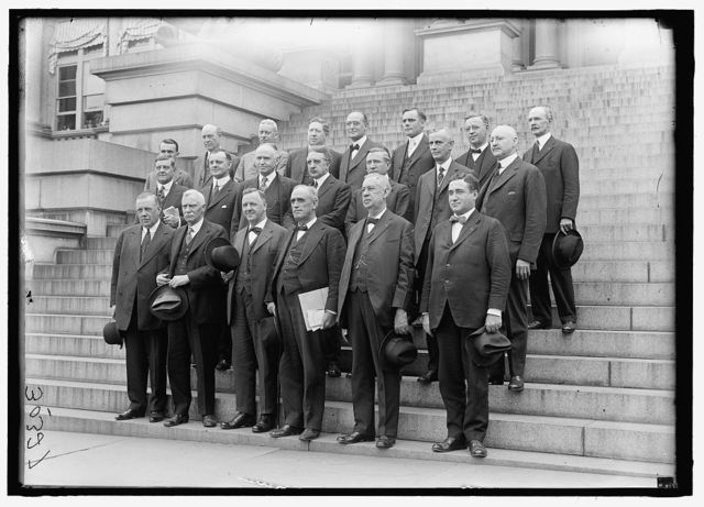 HOUSE OF REPRESENTATIVES. COMMITTEES. NAVAL AFFAIRS. ON NAVY DEPT. STEPS. FRONT: RIORDAN, DANIEL JOSEPH, OF NY; BUTLER, THOMAS STALKER OF PA; SEC. JOSEPHUS DANIELS; PADGETT, LEMUEL PHILLIPS, OF TN, CHAIRMAN; BROWNING, WILLIAM JOHN, OF NJ; McARTHUR, CLIFTON NESMITH, OF OR. 2ND ROW: OLIVER, WILLIAM BACON, OF AL; VINSON OF GA; KELLY, PATRICK HENRY OF MI.;HICKS, FRED. C.OF NY; BRITTEN, FRED A. OF IL; DARROW, GEORGE P., OF PA; STEPHENS OF OH. 3RD ROW: UNIDENTIFIED