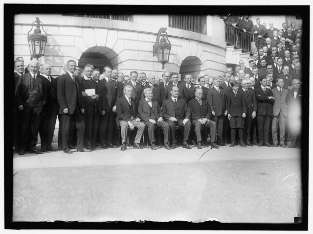 LABOR. LABOR REPS. AT WHITE HOUSE. SEATED: PRESIDENT WILSON; SEC. WILSON; SEC. HOUSTON; SEC. REDFIELD. ROGER BABSON IS STANDING 4TH LEFT OF WILSON; FRANK MORRISON IS EXTREME RIGHT IN 30047, AND 3RD FR