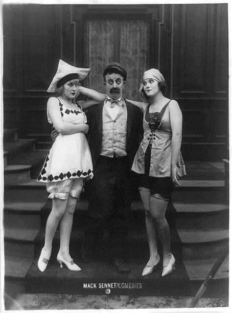 Marvel Rea (left), Chester Conklin and Peggie Cloud, appearing in Mack Sennett Comedies [standing together on step]